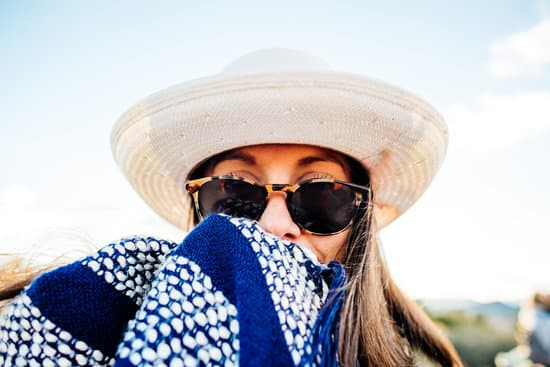 woman covered in clothing to protect from the sun